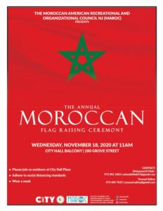Moroccan Flag Raising. Red Background with Green 5 pointed star centered towards top