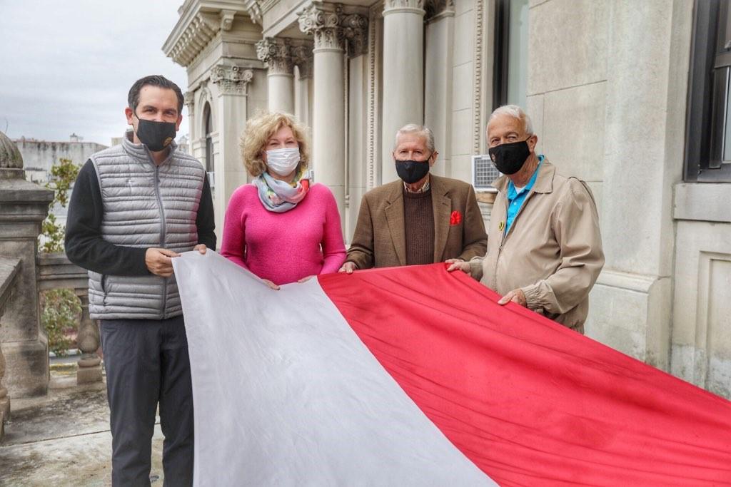 Polish Flag Raising 4 people holding Polish Flag before it is raised